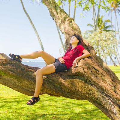 Woman relaxing on tree